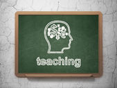 Education concept: Head With Finance Symbol and Teaching on chalkboard background — Stock Photo