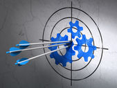 Data concept: arrows in Gears target on wall background — Stock Photo