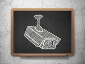 Safety concept: Cctv Camera on chalkboard background — Stock Photo