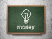 Business concept: Light Bulb and Money on chalkboard background — Stock Photo