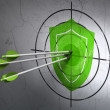 Privacy concept: arrows in Shield target on wall background — Stock Photo
