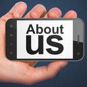 Marketing concept: About Us on smartphone — Stock fotografie