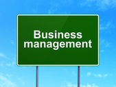 Finance concept: Business Management on road sign background — Stock Photo