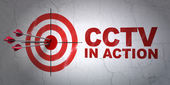 Safety concept: target and CCTV In action on wall background — Stockfoto