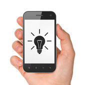 Business concept: Light Bulb on smartphone — Zdjęcie stockowe