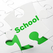 Education concept: School on puzzle background — Foto de Stock