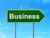 Finance concept: Business on road sign background — Stock Photo