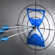 Timeline concept: arrows in Hourglass target on wall background — Stock Photo