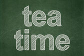 Time concept: Tea Time on chalkboard background — Stock Photo