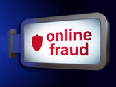 Protection concept: Online Fraud and Shield on billboard background — Stock Photo
