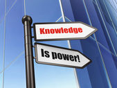 Education concept: sign Knowledge Is power! on Building background — 图库照片