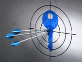 Safety concept: arrows in Key target on wall background — Stock Photo
