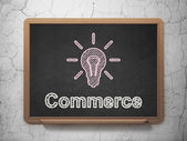 Business concept: Light Bulb and Commerce on chalkboard background — 图库照片