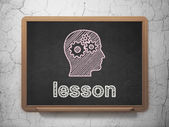 Education concept: Head With Gears and Lesson on chalkboard background — Stock Photo