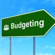 Business concept: Budgeting and Business People on road sign background — Stock Photo #36102631