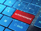 Education concept: Achievement on computer keyboard background — Stock Photo