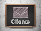 Business concept: Email and Clients on chalkboard background — Stock Photo