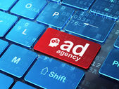Advertising concept: Head With Gears and Ad Agency on computer keyboard background — Stock fotografie