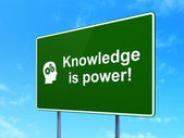 Education concept: Knowledge Is power! and Head With Gears on road sign background — Stock Photo