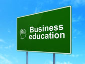 Education concept: Business Education and Head With Finance Symbol on road sign background — Photo