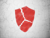 Safety concept: Broken Shield on wall background — Zdjęcie stockowe