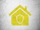 Security concept: Home on wall background — Zdjęcie stockowe