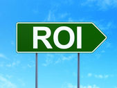 Business concept: ROI on road sign background — Stock Photo