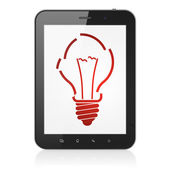 Business concept: Light Bulb on tablet pc computer — Stockfoto