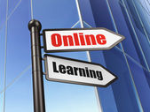 Education concept: sign Online Learning on Building background — Stock Photo