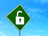 Safety concept: Opened Padlock on road sign background — Stockfoto