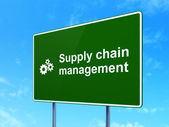 Advertising concept: Supply Chain Management and Gears on road sign background — Zdjęcie stockowe