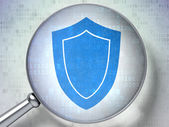 Protection concept: Shield with optical glass on digital background — Stock Photo
