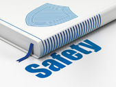 Protection concept: book Shield, Safety on white background — Stok fotoğraf