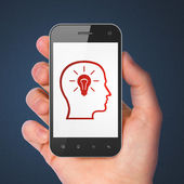 Marketing concept: Head With Lightbulb on smartphone — Stockfoto