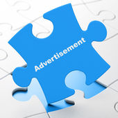 Marketing concept: Advertisement on puzzle background — 图库照片