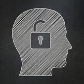 Business concept: Head With Padlock on chalkboard background — Stock Photo