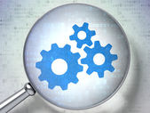 Advertising concept: Gears with optical glass on digital background — Stock Photo