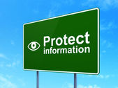 Safety concept: Protect Information and Eye on road sign background — Stock Photo