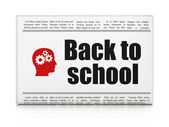 Education concept: newspaper with Back to School and Head With Gears — Stock Photo