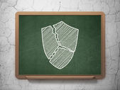 Safety concept: Broken Shield on chalkboard background — Stockfoto