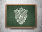 Safety concept: Broken Shield on chalkboard background — Stockfoto