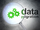 Data concept: Gears and Data Migration with optical glass — Stock Photo