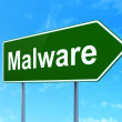 Safety concept: Malware on road sign background — Stock Photo
