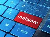 安全概念: 恶意软件在计算机键盘背景上 — 图库照片