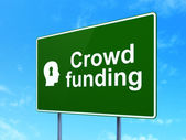 Business concept: Crowd Funding and Head With Keyhole on road sign background — Foto de Stock