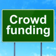 Business concept: Crowd Funding on road sign background — Stock Photo