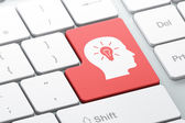 Education concept: Head With Light Bulb on computer keyboard background — Stock Photo