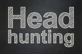 Finance concept: Head Hunting on chalkboard background — Stock Photo