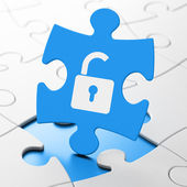 Safety concept: Opened Padlock on puzzle background — Stock Photo