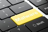 концепция безопасности: вредоносных программ на фоне компьютерной клавиатуры — Стоковое фото